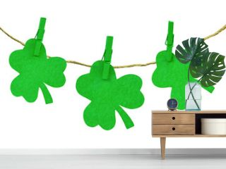 St. Patrick's Day theme with decorations. Green clovers and clothespins isolated on white background