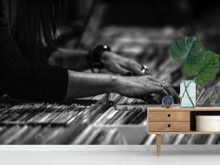 Close-up Of Hand Choosing Records At Store