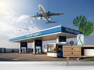 Fuel cell bus at the hydrogen filling station and airplane in the sky. Clean mobility concept