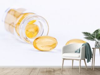 Medical yellow pill capsules and a glass bottle. Pharmaceutical medicament for health.