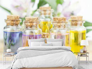 Set of colorful bottles with floral essential oil. Alternative medical concept.