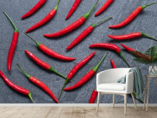 Several fresh Red hot chili pepper on a dark black stone background, food ingredient concept, top view.