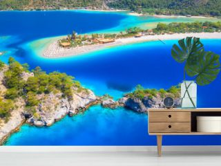 Aerial view of sea bay, rock, sandy beach, trees, mountain at sunny day in summer. Blue lagoon in Oludeniz, Turkey. Tropical landscape with island, white sandy bank, blue water. Top view. Nature