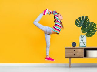 Profile photo of athletic girl stretch empty space wear striped shirt jeans sneakers isolated yellow color background
