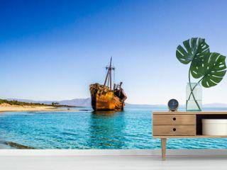 Rusty and abandoned shipwreck on a coastline near Gythio in Lakonia, Peloponnese Greece