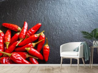 Close-up Of A Group Of Red Hot Chili Peppers On Slate