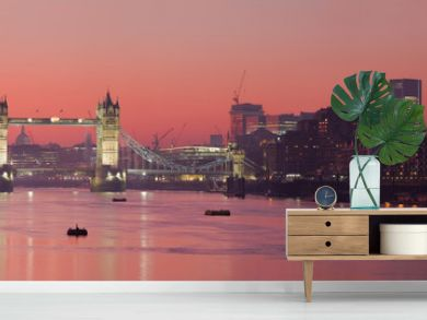 Tower Bridge and city of London with deep red sunset