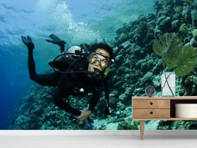 scuba diver on a wall dive