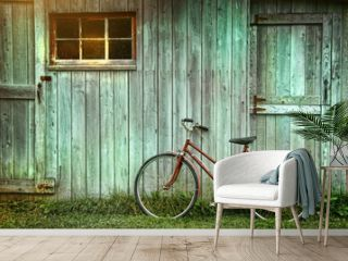 Old bicycle leaning against grungy barn