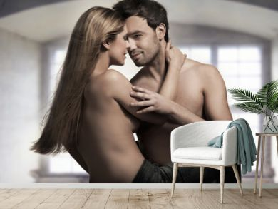 Young couple in blue jeans on nice interior