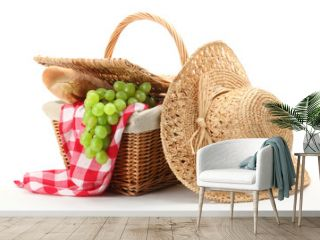 Picnic basket and straw hat