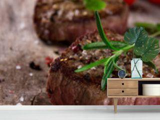 Grilled bbq steak on wooden background