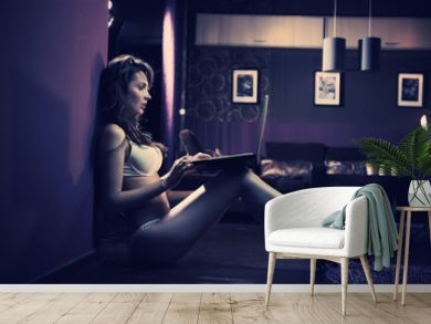 Sexy woman browsing internet late night