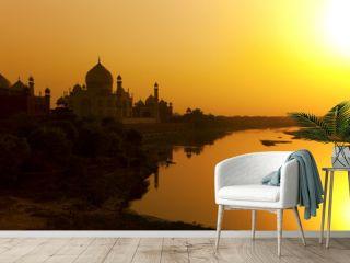 Taj Mahal with the Yamuna River at sunset, India.