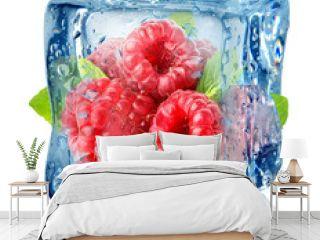 Ice cube and raspberries