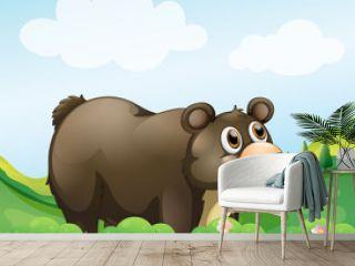 A big brown bear in the garden