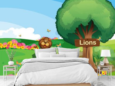 Two lions in the garden with a wooden signboard