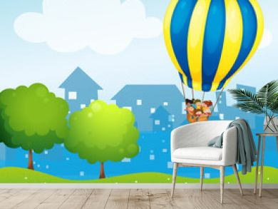 A big hot air balloon above the hill
