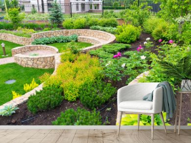 Landscape design in home garden, beautiful landscaped backyard of residential house