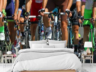 legs of cyclists who ride during the international race