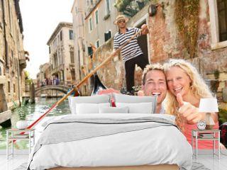 Travel concept - happy couple in Venice gondola