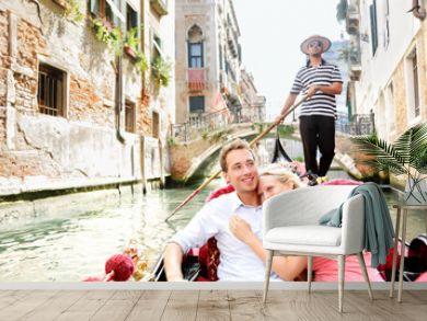 Romantic travel couple in Venice on Gondole boat