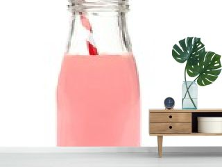 Strawberry milk with straw in a bottle with berries