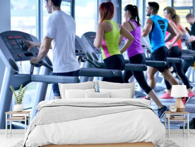 Group of people running on treadmills
