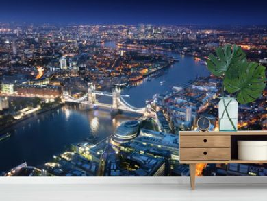 London at night with urban architectures and Tower Bridge