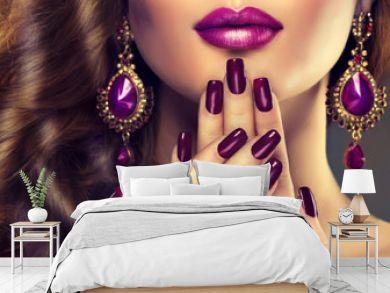 Luxury fashion style, manicure nail , cosmetics and make-up .  Jewelry , large purple earrings