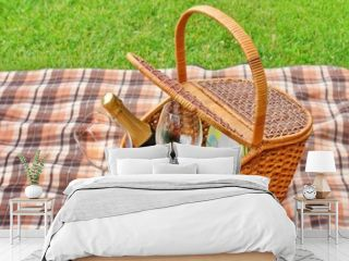 Picnic Basket On The Blanket Close-up. Lawn On The Background