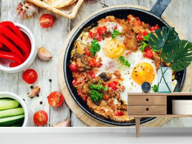 fried eggs with peppers, tomatoes, quinoa and mushrooms