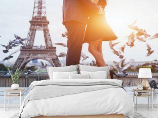 couple near Eiffel tower in Paris, romantic kiss