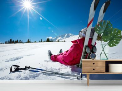 Skier relaxing at sunny day on winter season