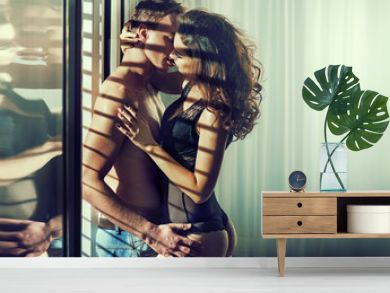 Sensual couple in romantic hotel's room