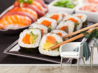 sushi pieces with chopsticks