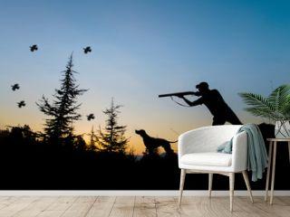 Hunting. Hunter and dog at sunset.
