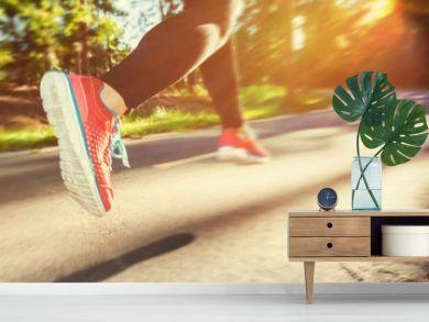 Woman runner jogging down an outdoor trail