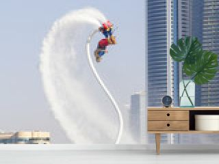 man on flayborde doing flip jump in international competitions in extreme water sports in Dubai, United Arab Emirates