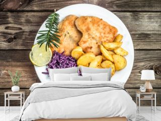 Dish on the wooden table. Fried salmon, potatoes and vegetables.