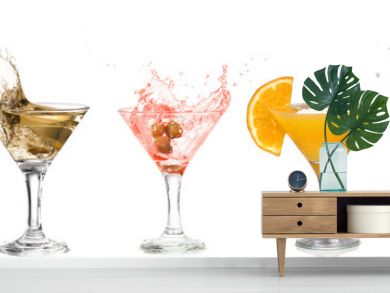 A martini glass on a white background  alcohol cocktail set with splash isolated on white  horizontal format