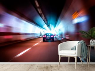 Luxurious car rides fast in a dark tunnel