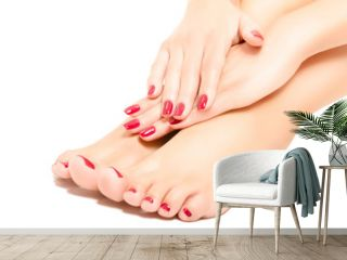 Beautiful  foot and hands with red manicure