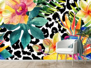 Tropical watercolor flowers and leaves on animal print