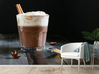 hot chocolate with whipped cream on the black table