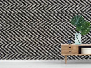 Herringbone (Broken Twill Weave) - a distinctive V-shaped weaving pattern. Closeup. Grey textured background.