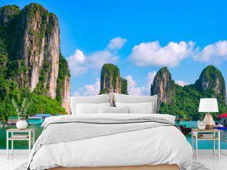 Floating fishing village and rock island in Halong Bay, Vietnam, Southeast Asia. UNESCO World Heritage Site. Junk boat cruise to Ha Long Bay. Landscape. Popular landmark, famous destination of Vietnam