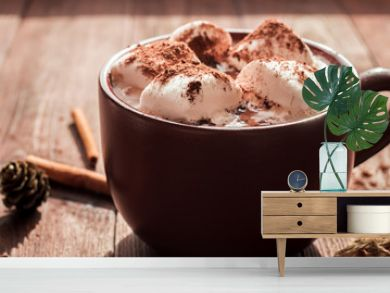 Christmas drink. Hot chocolate in a mug, marshmallows, cinnamon sticks and fir cones, close-up