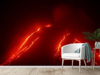 Volcanic landscape of Kamchatka: night view of eruption Klyuchevskaya Sopka, current lava flows on the slope of the volcano. Russian Far East, Kamchatka Region, Klyuchevskaya Group of Volcanoes.