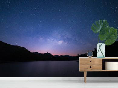 Peaceful starry night sky on the river landscape background